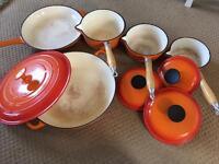 Set of cast iron cookware, saucepan, frying pan and casserole type dish