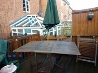 Lovely sturdy teak wooden garden table with 4 chairs and umbrella vgc
