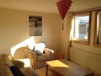 Spacious, sunny, central 3 bedroom flat with private parking