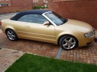 Audi A4 Automatic Cabriolet. Gold with Navy roof. 12 months MOT FSH handfree phone parking sensors