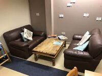 Two Brown Leather Sofas & Coffee Table