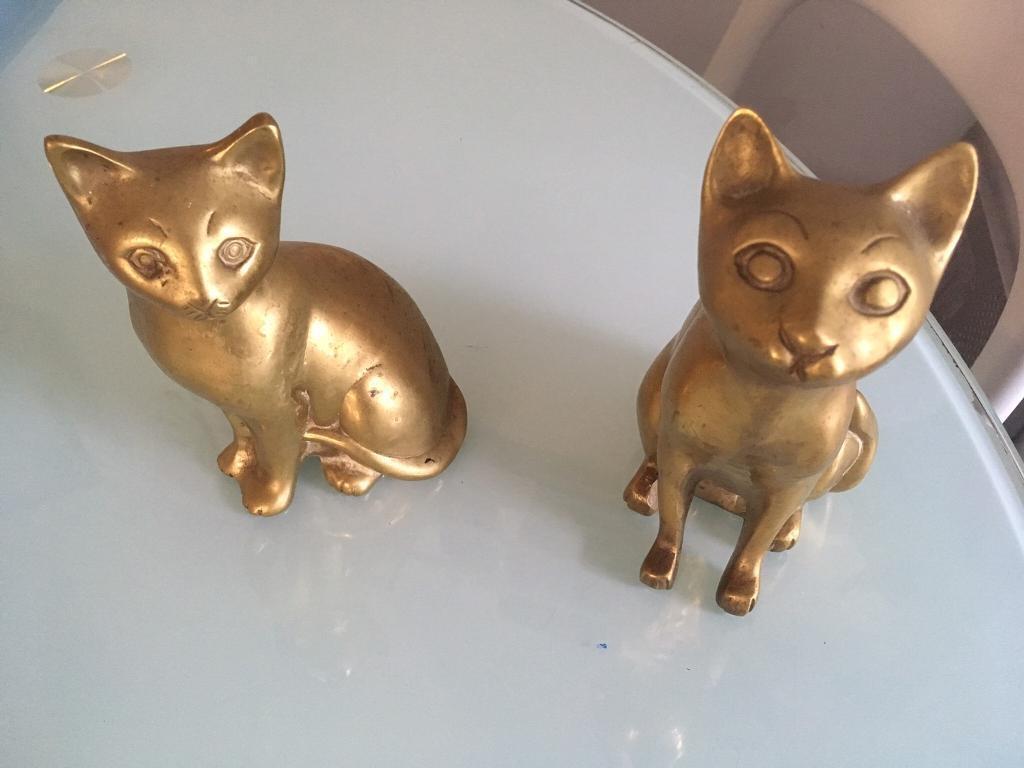 Brass ornamental cats