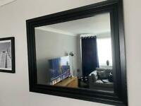 Black framed mirror and set of 3 black and white photos