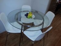 "Round glass table "" SALMI"" with 4 chairs ""LEIFARNE"" almost new from IKEA"