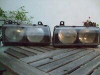 pair of BMW 316 headlights