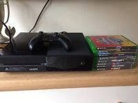 X Box One and 8 games for sale
