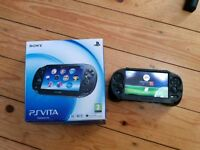 Ps vita with 2 games fifa 15 and Virtual Tennis 4 World Tour Edition Plus hand grip