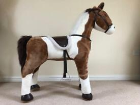 Sit on toy horse.