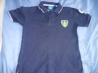 Leeds United polo shirt aged 5-6 years