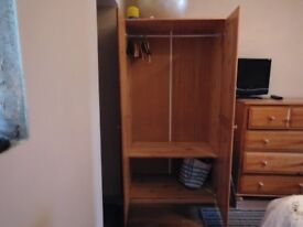 2 door solid pine wardrobe with hanging pole and shoe shelve