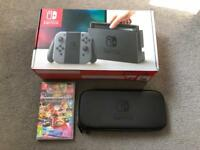 Nintendo switch console, Mario kart game and official hard case.