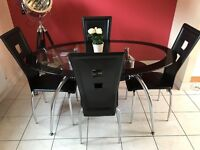 Black and silver dining table and 4 chairs