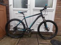 REDUCED IN PRICE BH PEAK SPIKE 5.7 MOUNTAIN BIKE. GREAT CONDITION. HYDRAULIC DISC BRAKES. 27 SPEED.