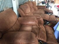 Brown leather sofa and chairs reclining
