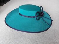 Very smart green hat with navy blue trim