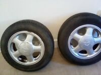 "14"" alloys with nissian centers and tyres"