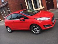 RED FORD FIESTA LOW MILAGE. GREAT CONDITION