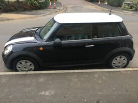 2010 Mini First, black with white roof and bonnet.