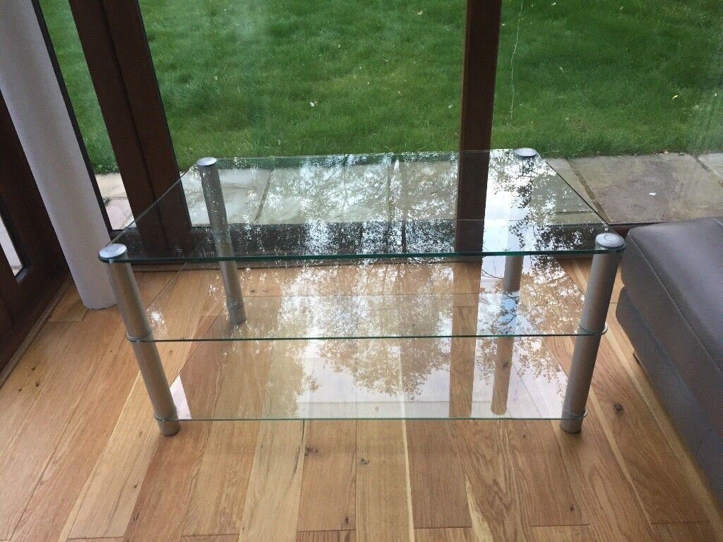 Attractive Glass TV stand with shelves