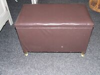 wicker blanket box covered with faux leather