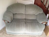 A very comfortable pale green two seater sofa free to you when you pick it up.