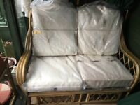 Unused two 2 seater conservatory wicker / rattan sofa settee- cream