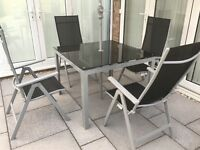 Outdoor table and four chairs for sale. Very good condition.