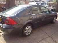 Ford Mondeo Ghia 2000 Diesel TDCi 115 in metallic grey.