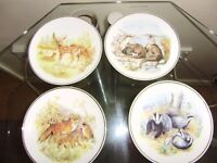Set of 4 decorative plates, perfect condition, highly collectible