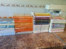 Mostly paperback books with a couple of hardbacks. Some are are series of books.