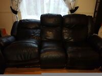 2x 3 seater black leather electric recliner sofas.