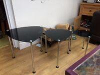 Nest of three black glass tables