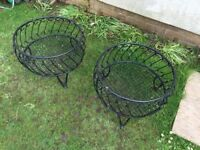 2 black wrought planters plastic coated