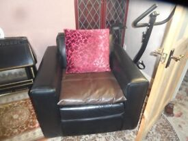 Black leather look chair and poufee