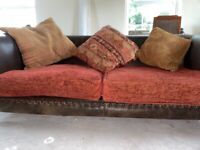 Brown leather sofa and two bucket/ tub armchairs