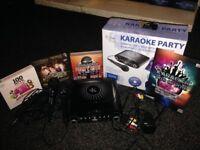 Karaoke machine, mics and cdgs