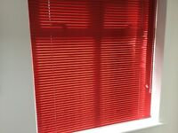 Two bright red rol-lite Venetian blinds 115.5 w x 130 drop.
