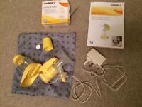 Medela electric breast pump with storage bags