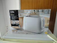 Unused electric 2 slice toaster.