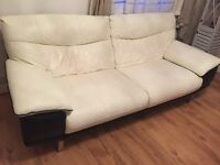 Leather sofa, large 3 seater, white with black trim. Excellent condition.