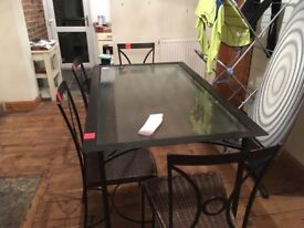 Metal/glass dining table and chairs
