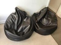 Two brown faux leather bean bags
