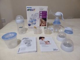 Breast pump manual AVENT in excellent condition + extra bottle , 7 teats and food warming bag