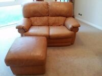 2 seater tan leather sofa and matching foot stool - still in good condition with some wear