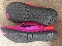 Nike Women's Free Flyknit 3.0 running shoes: Bright orange and purple. Size 5.5