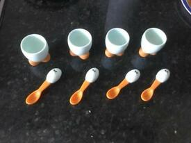 Set of 4 novelty egg cups with spoons