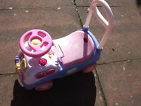 Girls toy sit on car and girl toddler books and dvds