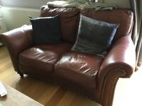 Brown chestnut studded two seater sofa