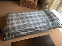 Folding single bed with foam mattress