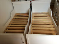 two white Ikea Sundvik kids beds complete with slats & matresses